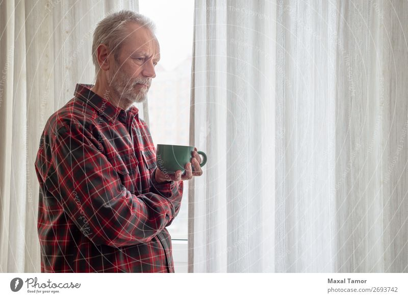 Thoughtful mature man drinking his coffee close to the window Drinking Coffee Tea Human being Man Adults Town Observe Think Stand Sadness Wait Green Red White