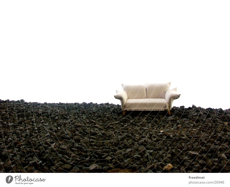 white sofa on black stone Relaxation Sofa Furniture Misplaced Canola Field Green Yellow Monstrous Empty Plant Seating Sleep Rest Living room Heavenly
