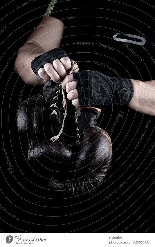 pair of very old boxing sports gloves in men's hands Human being Man Old Hand Black Lifestyle Adults Sports Brown Body Dirty Power Success Fitness Protection