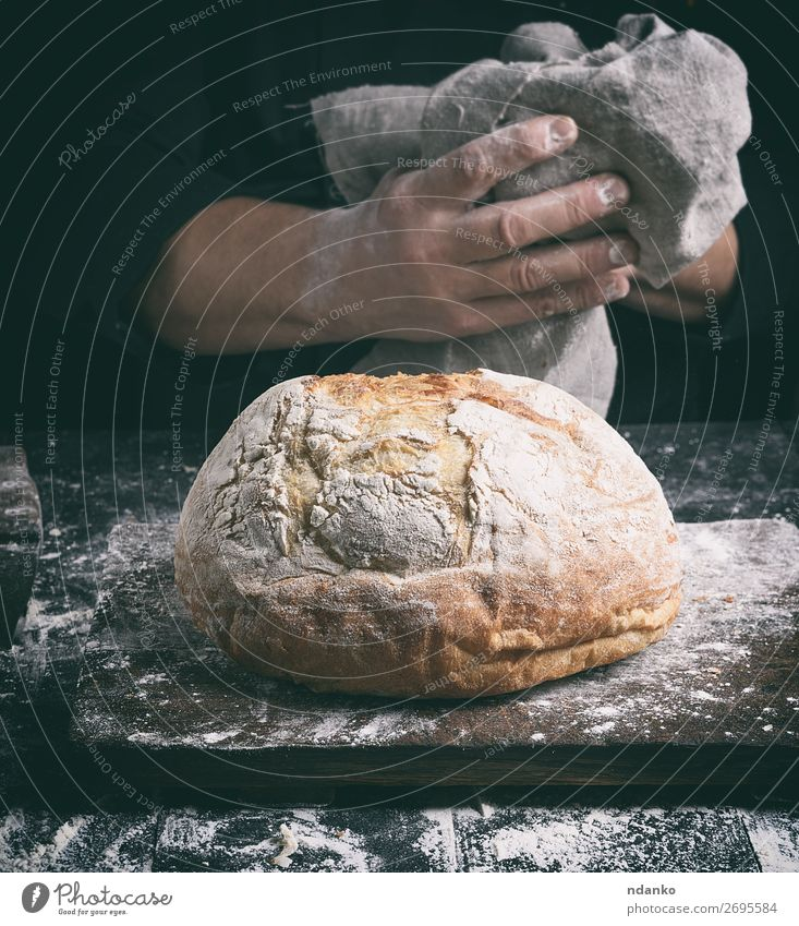 baked round bread on a board Bread Nutrition Table Kitchen Human being Hand Fingers Wood Make Dark Fresh Brown Black White Tradition Baking Baker Bakery cook