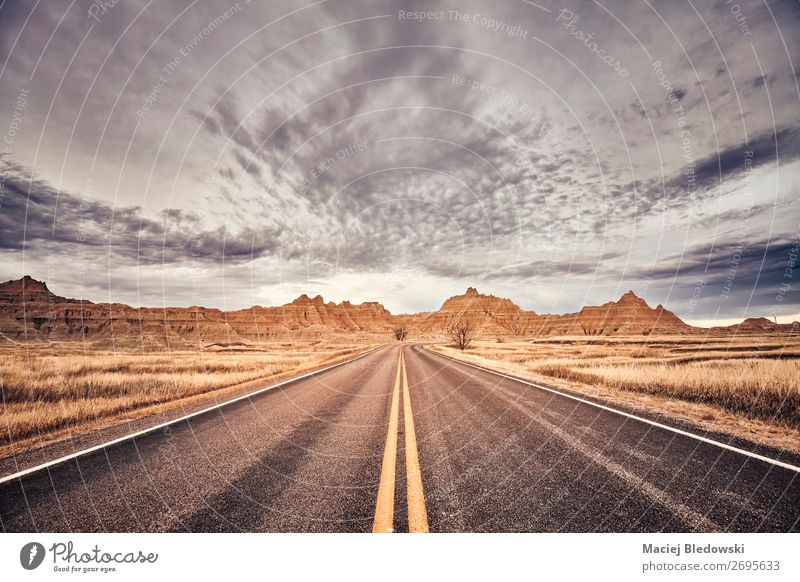 Scenic road in Badlands National Park, USA. Vacation & Travel Tourism Trip Adventure Far-off places Freedom Camping Summer Summer vacation Mountain Nature