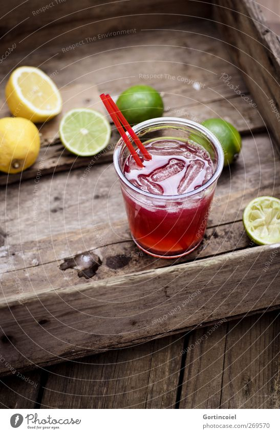 cocktail Food Fruit Beverage Cold drink Longdrink Cocktail Glass Straw Fresh Delicious Lemon Lime Ice cube Wooden table Food photograph Summery