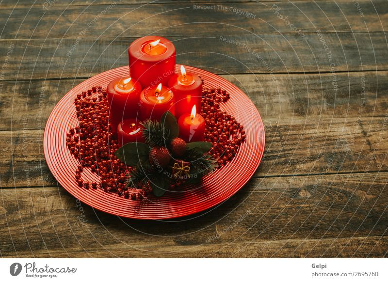 Lighted candles with red colored pearls around Christmas & Advent Red Winter Wood Religion and faith Feasts & Celebrations Decoration Bright Glittering Candle