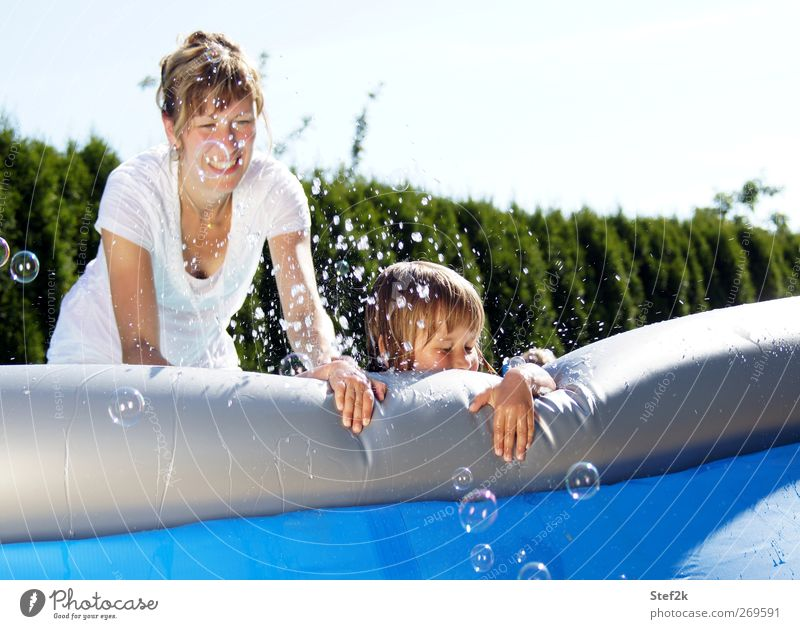 family pool action Joy Summer Feminine Girl Young woman Youth (Young adults) Mother Adults Family & Relations Life 2 Human being 3 - 8 years Child Infancy