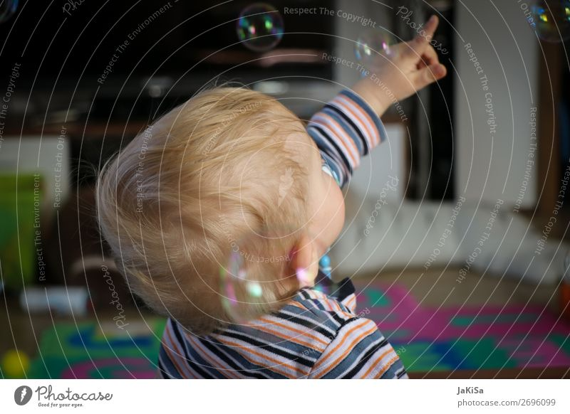 Kid playing with bubbels Playing Children's game Soap bubble Living room Toddler Infancy Life Head Hand 1 Human being 1 - 3 years Observe Touch Catch Blonde