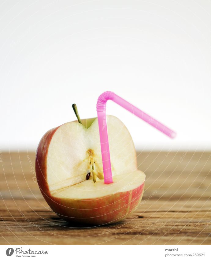 AppleJuice Food Fruit Nutrition Beverage Drinking Cold drink Sweet Green Pink Red Apple juice Blade of grass Funny Wooden table Fresh Fruity Colour photo