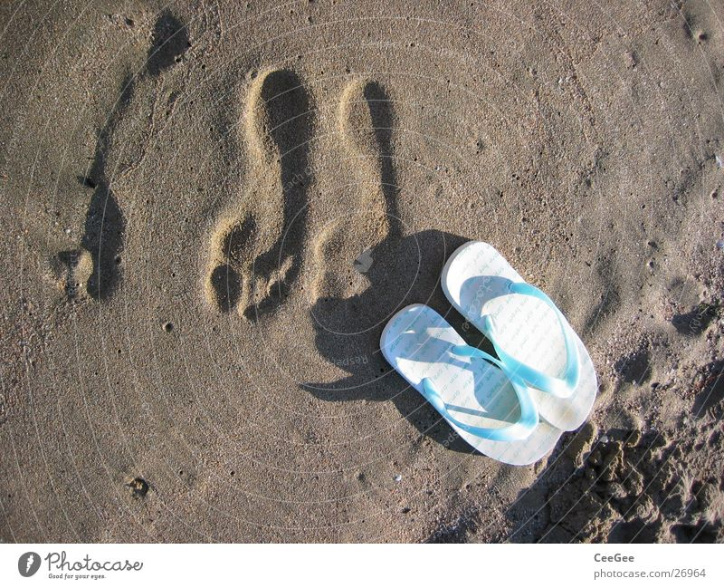 gone Flip-flops Beach shoes Footwear Ocean Footprint Wet Damp Leisure and hobbies Sand Water Feet Shadow Barefoot