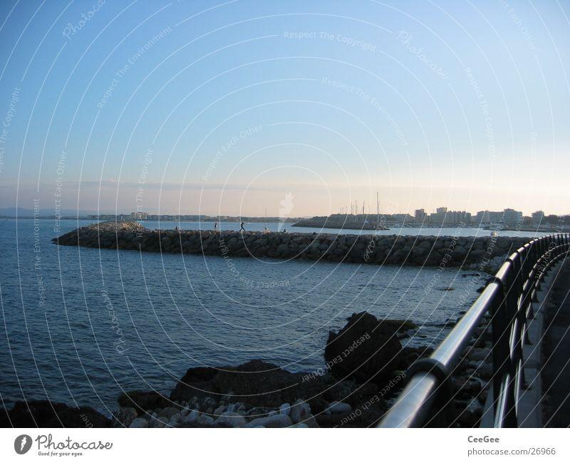 View to the harbour wall Wall (barrier) Jetty Light Exposure Twilight Ocean Spain Water Stone Fragment Rock Sun Harbour estartite Sky Blue Handrail Metal