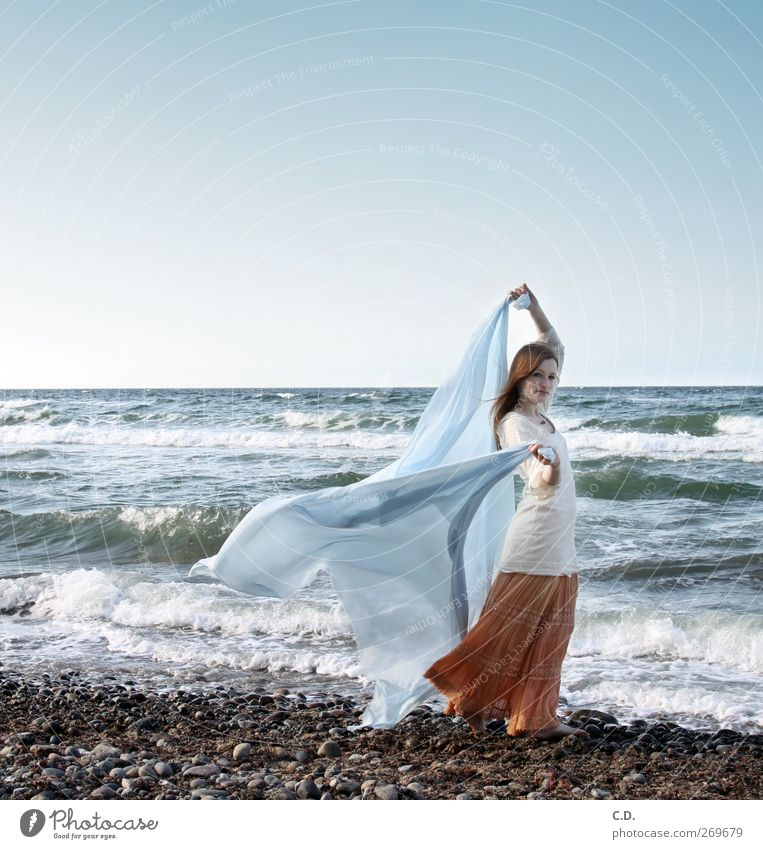 Human being Sky Nature Youth (Young adults) Blue Beautiful Ocean Beach Adults Spring Stone Orange Waves Young woman Wind Elegant