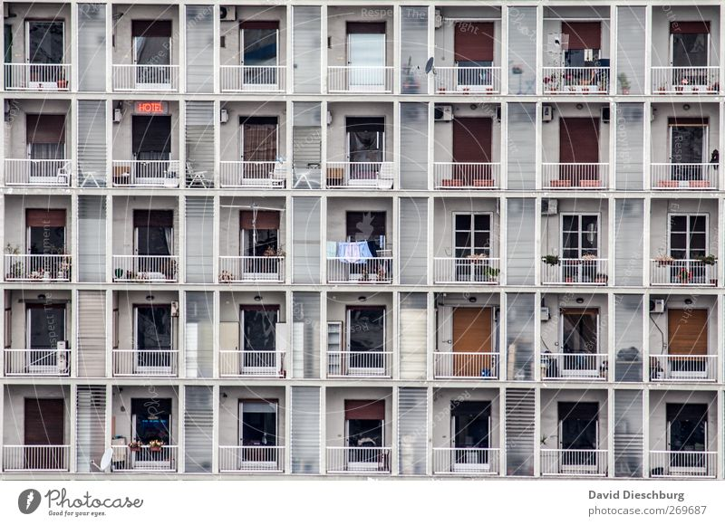 Standardized living Town Overpopulated House (Residential Structure) High-rise Manmade structures Facade Balcony Window Door Roller shutter Handrail Rectangle