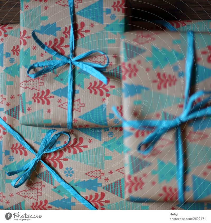 three wrapped gifts in turquoise-red patterned Christmas paper with turquoise bast bows Christmas & Advent Packaging Decoration Bow Gift Bast Paper
