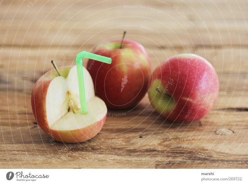 apple juice production Food Fruit Nutrition Beverage Drinking Cold drink Lemonade Juice Red Apple Juicy Fruity Blade of grass Wooden table Colour photo