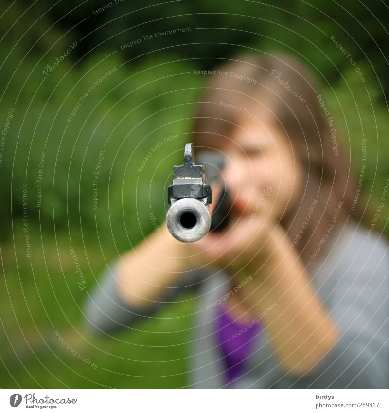 Young woman with rifle in attack aims at camera, muzzle of rifle Airgun Youth (Young adults) 1 Human being Summer Rifle Threat Rebellious Feminine