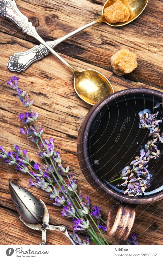 tea with lavender. flower natural herb herbal cup drink beverage plant medicine purple aromatic care healing spoon dry alternative herbal tea relaxation