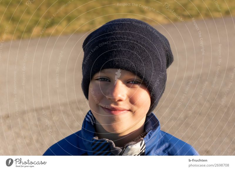 Boy with cap, outside, autumn Joy Leisure and hobbies Hiking Child Boy (child) Face 1 Human being Lanes & trails Jacket Cap Stand Friendliness Happiness