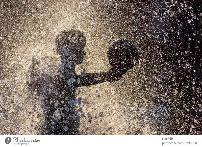 Figure of a fountain in the city of Rostock Vacation & Travel Tourism Summer Sun Sculpture Water Drops of water Sphere Leisure and hobbies Joy Art