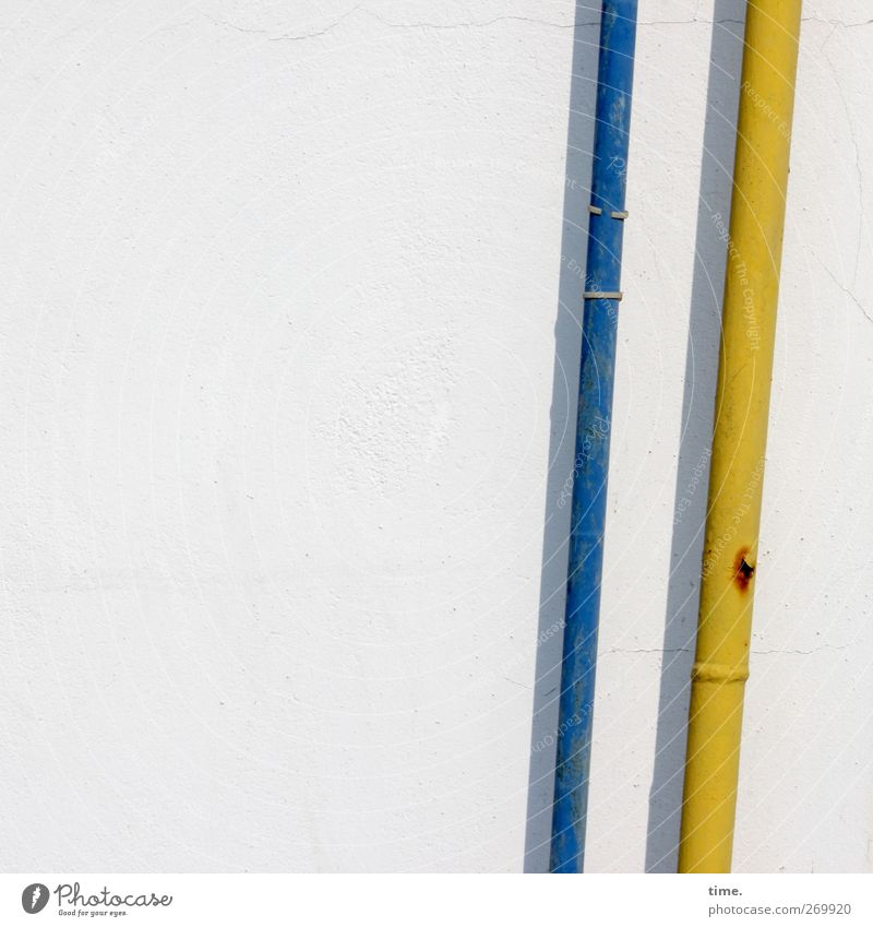 short time fellows Wall (barrier) Wall (building) Attachment Conduit Plastic Blue Yellow Rust Bracket Parallel Exterior shot Close-up Detail Pattern