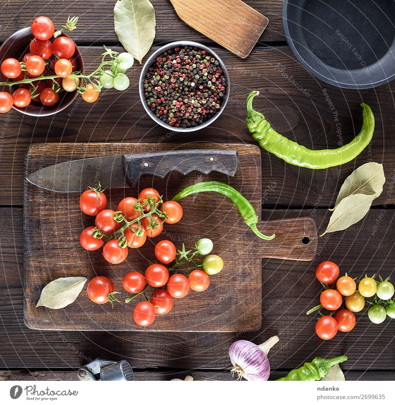 ripe red cherry tomatoes on a brown wooden table Vegetable Herbs and spices Vegetarian diet Pot Pan Knives Summer Kitchen Wood Fresh Small Natural Above Green