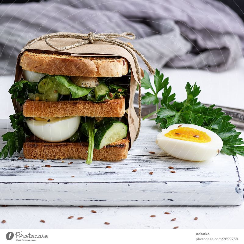 sandwich of French toast and lettuce leaves and boiled egg Meat Vegetable Bread Breakfast Lunch Dinner Vegetarian diet Healthy Eating Table Wood Fresh Delicious