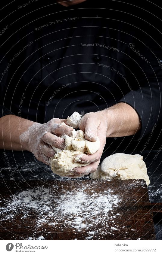 baker kneads white wheat flour dough Dough Baked goods Bread Nutrition Table Kitchen Work and employment Cook Human being Man Adults Hand Fingers Wood Make