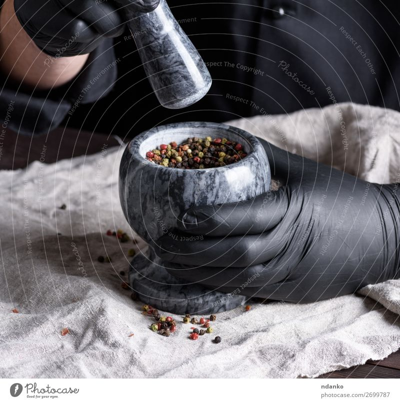 cook in black latex gloves holding a stone mortar with pepper Herbs and spices Bowl Table Kitchen Work and employment Cook Tool Human being Man Adults Hand