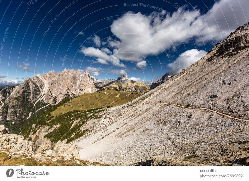 # 798 Three peaks Dolomites Sexten Dolomites World heritage High plain Colour photo Hiking Footpath Peak Mountaineering Alps Beautiful weather Meadow Summer Sun