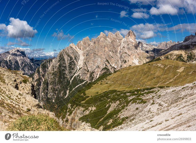 # 797 Three peaks Dolomites Sexten Dolomites World heritage High plain Colour photo Hiking Footpath Peak Mountaineering Alps Beautiful weather Meadow Summer Sun