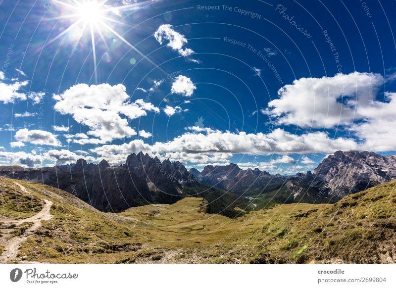 # 836 Three peaks Dolomites Sexten Dolomites World heritage High plain Colour photo Hiking Footpath Peak Mountaineering Alps Beautiful weather Meadow Summer Sun