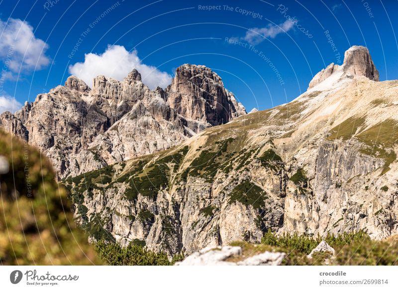 # 830 Three peaks Dolomites Sexten Dolomites World heritage High plain Colour photo Hiking Footpath Peak Mountaineering Alps Beautiful weather Meadow Summer Sun