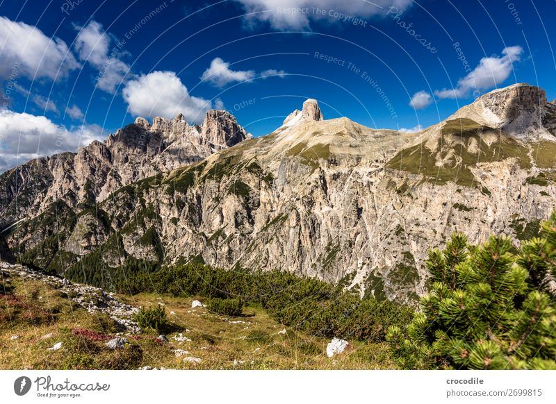 # 829 Three peaks Dolomites Sexten Dolomites World heritage High plain Colour photo Hiking Footpath Peak Mountaineering Alps Beautiful weather Meadow Summer Sun