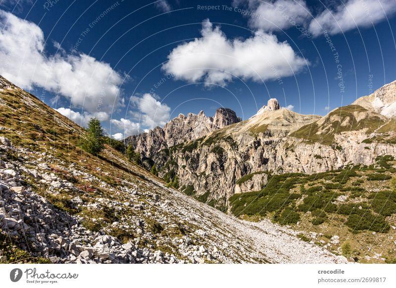 # 828 Three peaks Dolomites Sexten Dolomites World heritage High plain Colour photo Hiking Footpath Peak Mountaineering Alps Beautiful weather Meadow Summer Sun