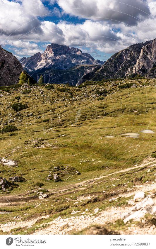 # 817 Three peaks Dolomites Sexten Dolomites World heritage High plain Colour photo Hiking Footpath Peak Mountaineering Alps Beautiful weather Meadow Summer Sun