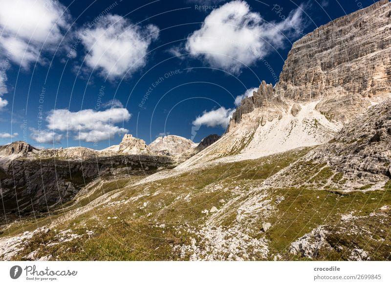 # 807 Three peaks Dolomites Sexten Dolomites World heritage High plain Colour photo Hiking Footpath Peak Mountaineering Alps Beautiful weather Meadow Summer Sun