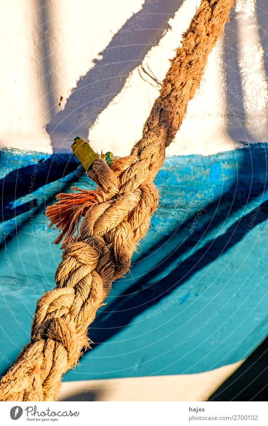 Old mooring line on a fishing boat Design Maritime Blue Multicoloured White mooring rope ship ship's side white blue Light Shadow sunny Harbour lashed
