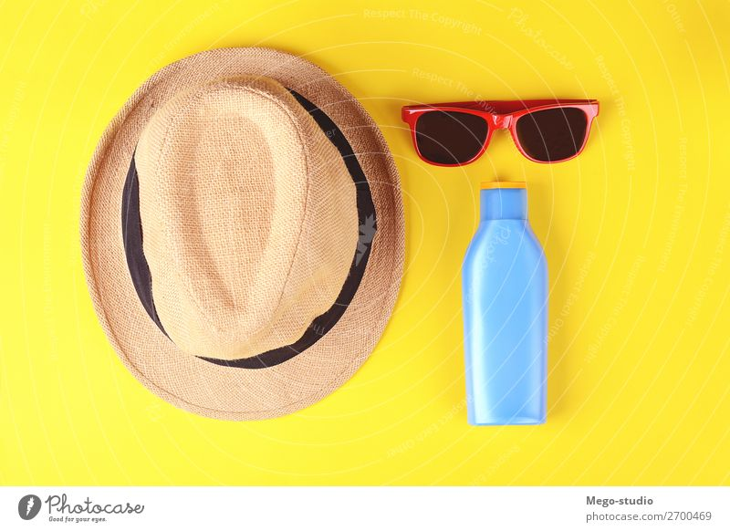 Top view of sunglasses, sunblock and hat Bottle Lifestyle Body Skin Cream Relaxation Vacation & Travel Tourism Summer Sun Sunbathing Beach Ocean Sand Accessory