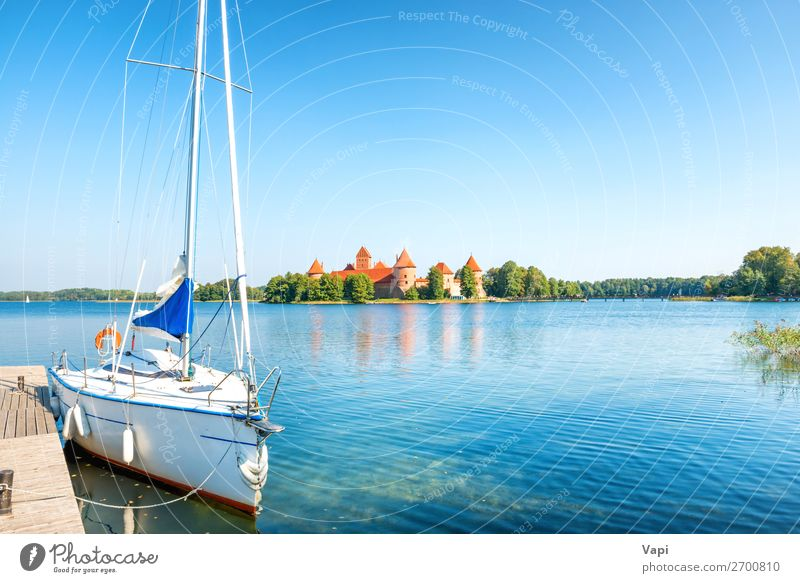 Trakai castle on lake with yacht Sky Vacation & Travel Nature Summer Blue Town Beautiful Green Water White Landscape Red Tree Architecture Lifestyle Autumn