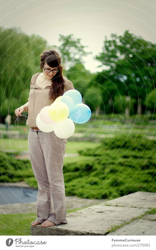 Blown up. Summer Feminine Young woman Youth (Young adults) Woman Adults 1 Human being 18 - 30 years Leisure and hobbies Joy Birthday Preparation Balloon Looking