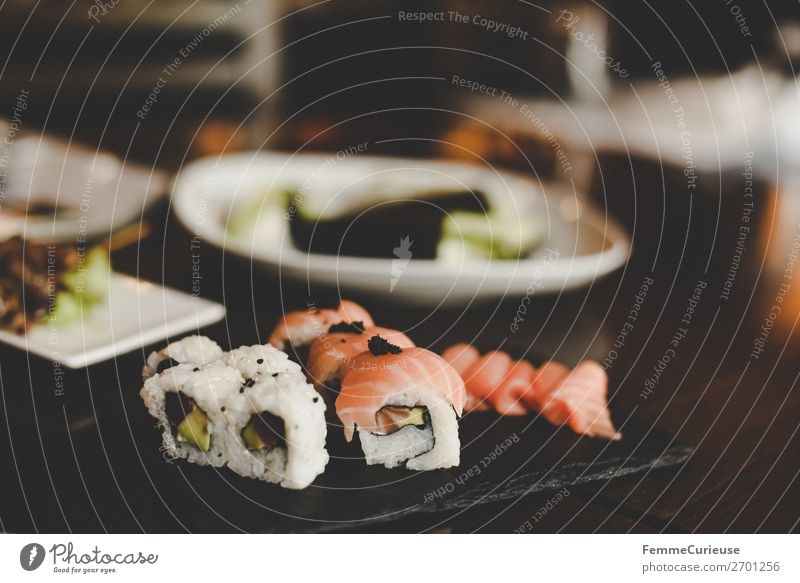 Sushi on black slate plate Food Fish Seafood Nutrition Buffet Brunch Organic produce Asian Food To enjoy Salmon Avocado Rice Healthy Eating Protein Restaurant