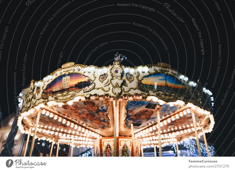 Illuminated carousel Leisure and hobbies Movement Carousel Attraction Fairs & Carnivals Lighting Multicoloured Night sky Evening Electric bulb Colour photo