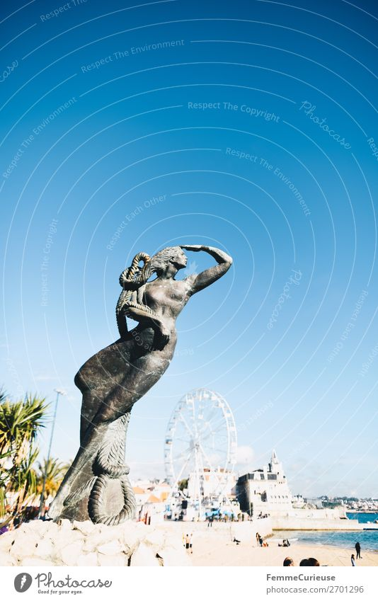 Close-up of a mermaid statue, view of the Atlantic Ocean Port City Vacation & Travel Statue Cascais Portugal Woman Ferris wheel Travel photography Vacation mood