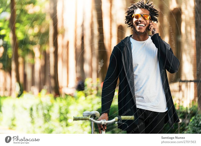 Afro young man using mobile phone and fixed gear bicycle Man Youth (Young adults) African Black Lifestyle attractive handsome urban Modern Self-confident Mobile