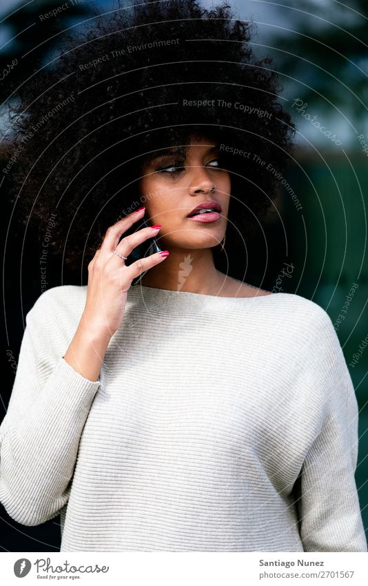 Portrait of attractive afro woman using mobile phone in the street Woman Black African Afro Human being Portrait photograph City Youth (Young adults) Mobile