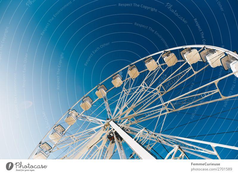 Ferris wheel in front of blue sky Port City Movement Cascais Portugal Blue sky Fairs & Carnivals Sunbeam Vacation mood White Colour photo Exterior shot