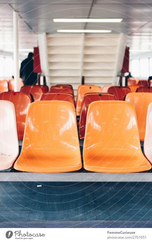 Interior of a ferry with colourful seats Transport Means of transport Passenger traffic Public transit Navigation Steamer Ferry Vacation & Travel Seating Orange