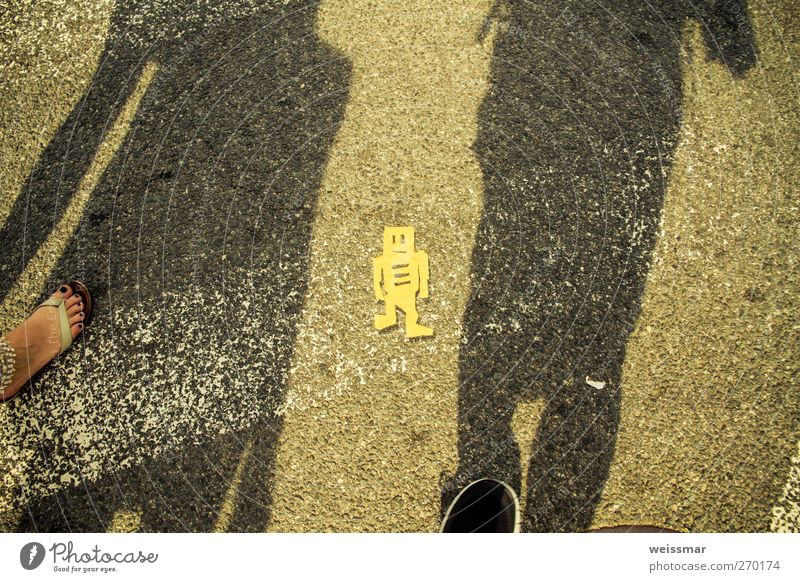 A sign from another world Robot Robotics Technology High-tech Shadow Shadow play 2 Human being Washington DC USA North America Town Street Walking Warmth Yellow