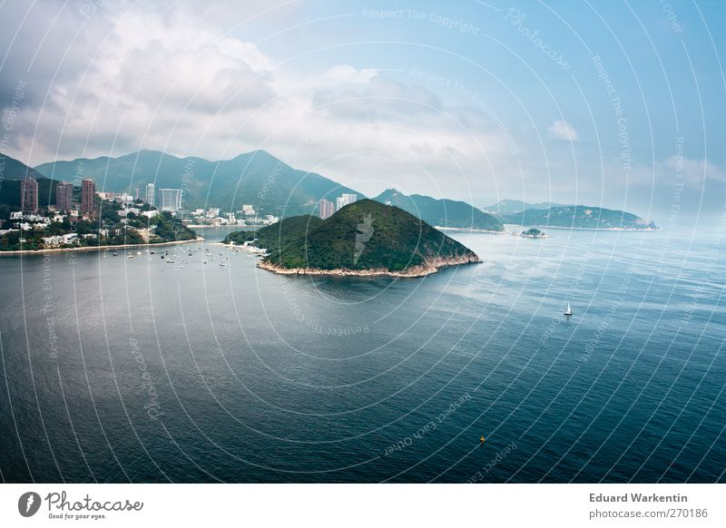 Sky Blue Water City Ocean Clouds Far-off places Landscape Mountain Freedom Coast Building Island Beautiful weather Asia Bay