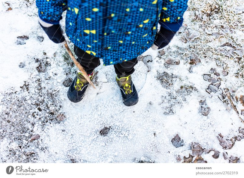 Child´s legs over a frozen ground in winter Lifestyle Relaxation Leisure and hobbies Adventure Winter Snow Winter vacation Mountain Hiking Human being Baby