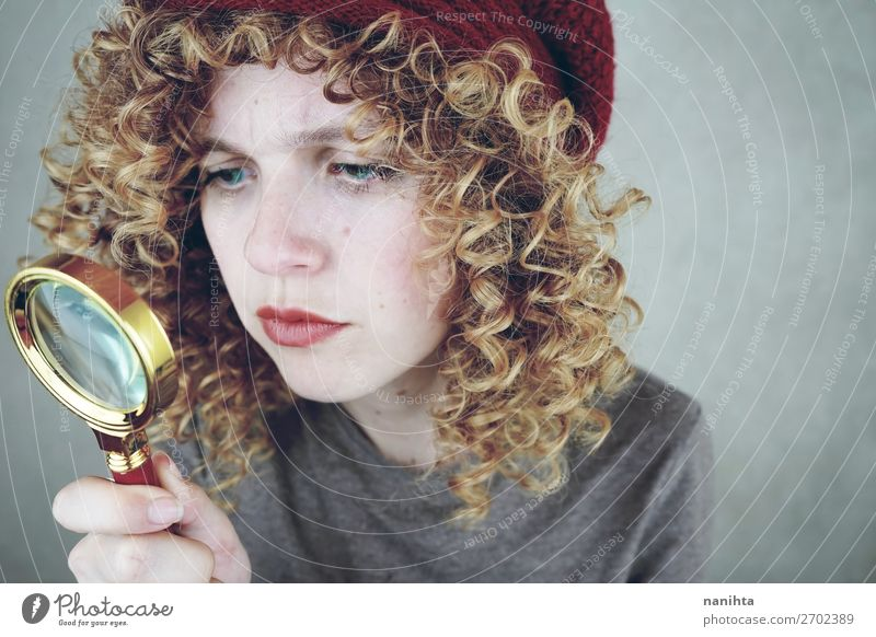 portrait of a young woman holding a magnifying glass Woman Human being Youth (Young adults) Young woman Blue Beautiful 18 - 30 years Face Adults Natural Funny