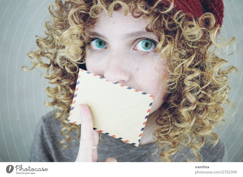 young woman covering her mouth with a letter Woman Human being Youth (Young adults) Young woman Beautiful 18 - 30 years Face Adults To talk Natural Funny