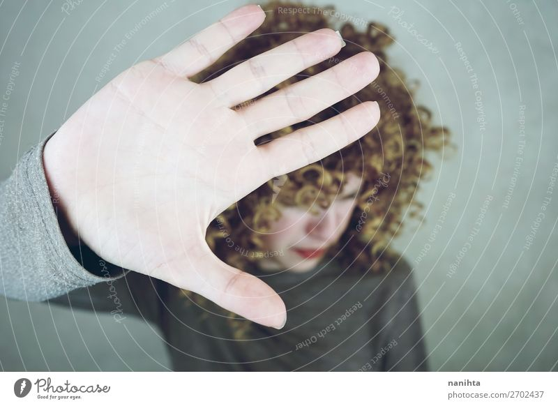 Young woman covering her face with her hand Style Beautiful Face Woman Adults Hand Fashion Blonde Cool (slang) Natural Cute Soft Anger Sadness Disappointment